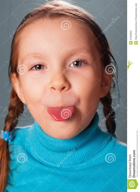 tiny small little girl showing the tongue stock photo image 27209820