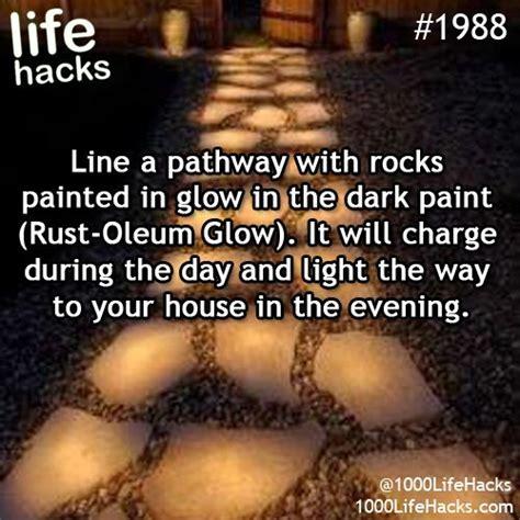 glow in the paint rocks the 25 best driveway lighting ideas on logs