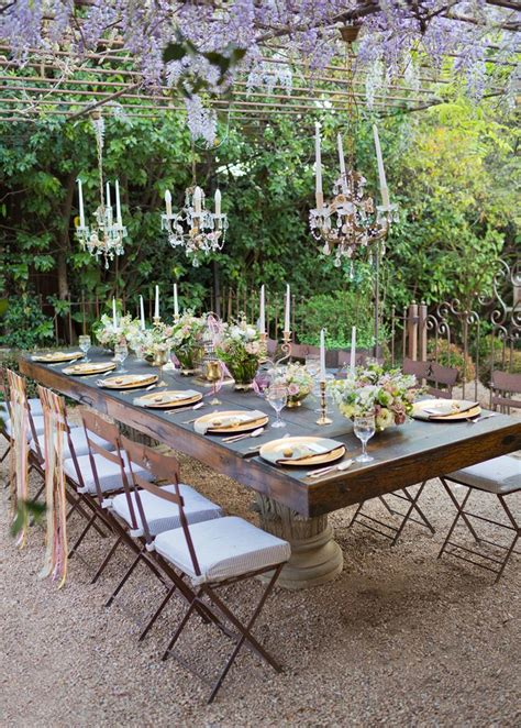 backyard dining intimate can still be glam pergola wisteria blooms