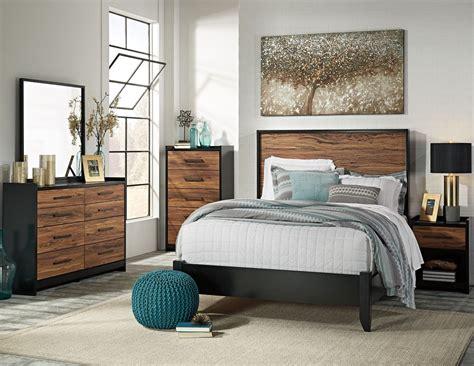black panel bedroom set stavani black and brown panel bedroom set from ashley