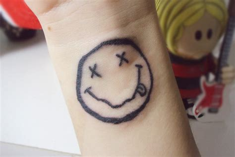 evil smiley tattoo smiley running image pictures to pin on tattooskid