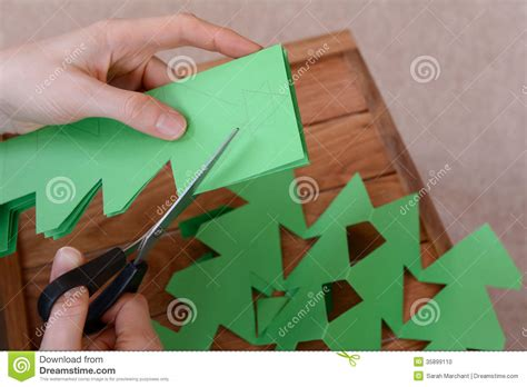 How To Make A Paper Chain - a paper chain of trees stock photo