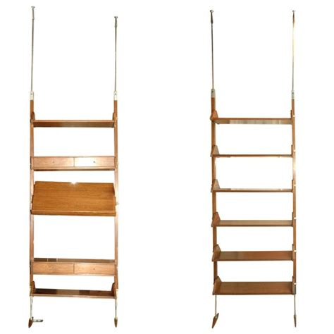 pair of free standing adjustable shelving units