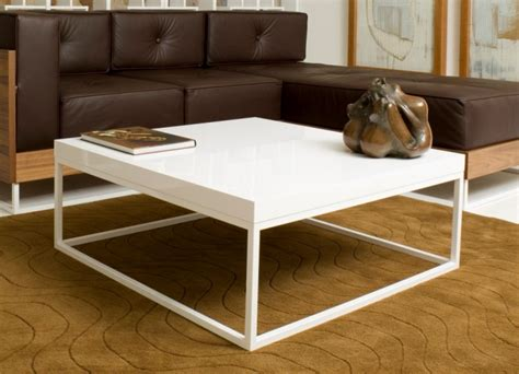two white sofas and a wooden coffee table in front of a coffee table breathtaking large white coffee table large