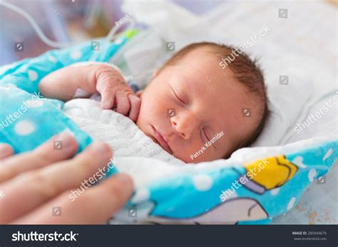 newborn baby after c section newborn baby boy in the hospital after c section stock