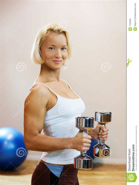 how to photograph heavy women woman lifting heavy dumbbells stock photography image
