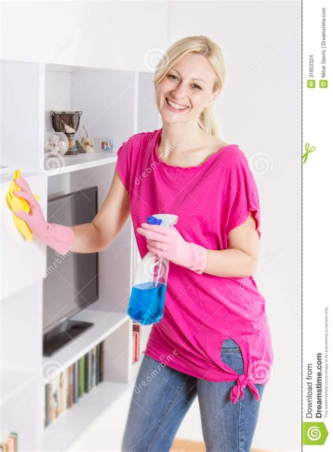 happy cleaning furniture at home stock images