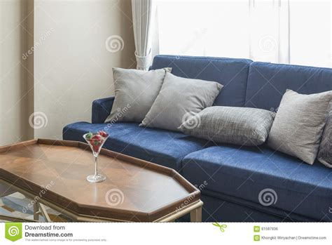 grey sofa with blue pillows luxury blue sofa with grey pillows and wooden table stock