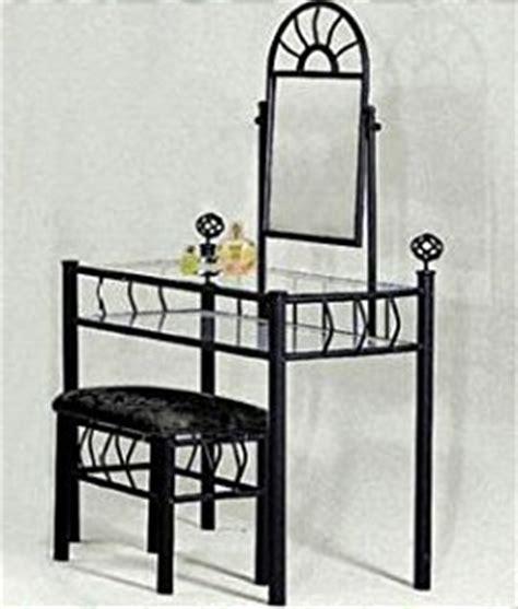 black metal bedroom vanity with glass table