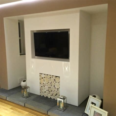 Decorative Logs In Fireplace by A Modernised Inglenook Fireplace Filled With Whitewash