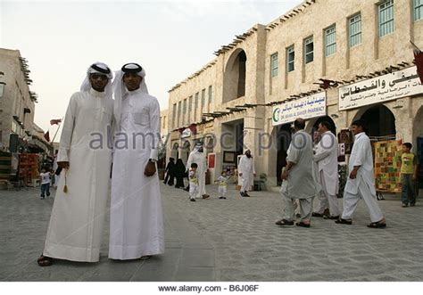 men long hair doha qatar qatari men in traditional dress stock photos qatari men