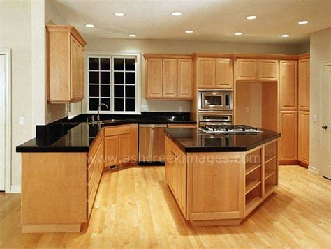 kitchen colors with oak cabinets and black countertops black counter tops and wood floors with the light