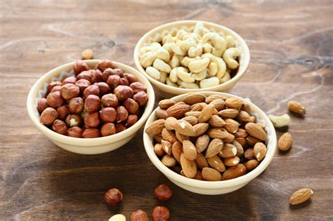 nuts in bowls cashews almonds and hazelnuts jpg
