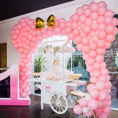 como decorar fiesta minnie mouse rosa  primer ano de