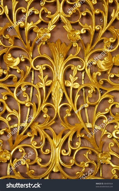 gold pattern metal gold metal pattern on wood background stock photo 88489564