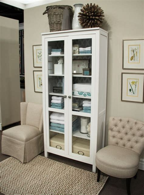 bathroom linen cabinet with glass doors good better best linen closet steven and chris