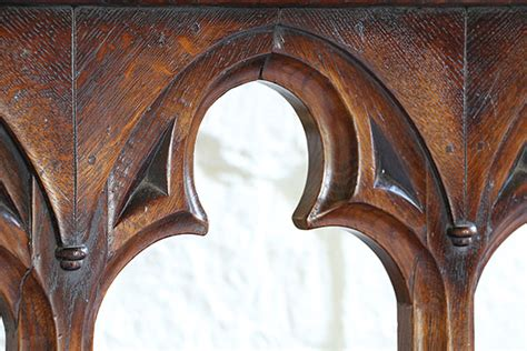 what is the meaning behind the gothic trefoil historic open oak tracery detail on gothic bed headboard