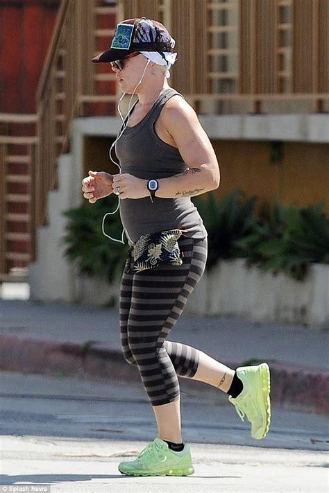 pink jogs through santa monica in striped leggings daily