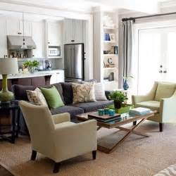 Pillows in cooler tones to add calm and color to a space anchored by a