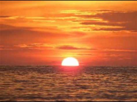 foto matahari terbenam  pantai pentadu paguat kab