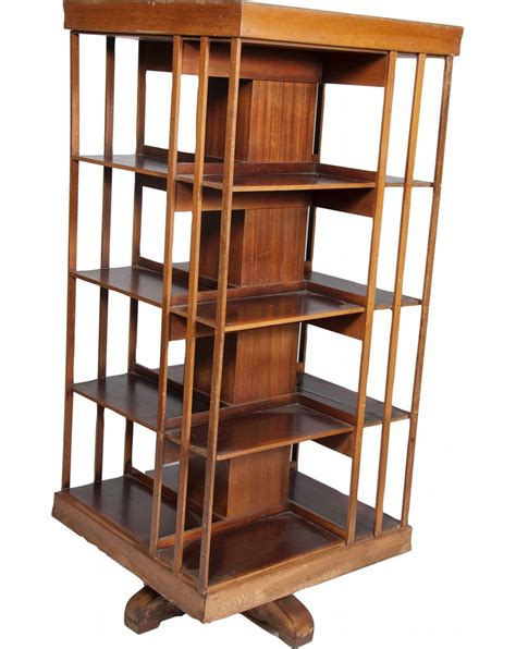 large wooden 4 sided bookshelf on swivel base