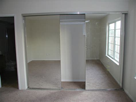Sliding Closet Mirror Doors by Installing Sliding Closet Doors For Design Ideas And