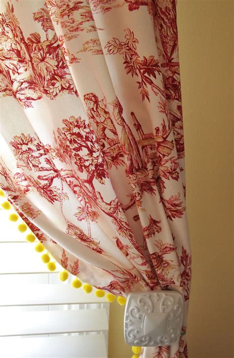 yellow toile curtains red toile curtains with yellow pom pom fringe a