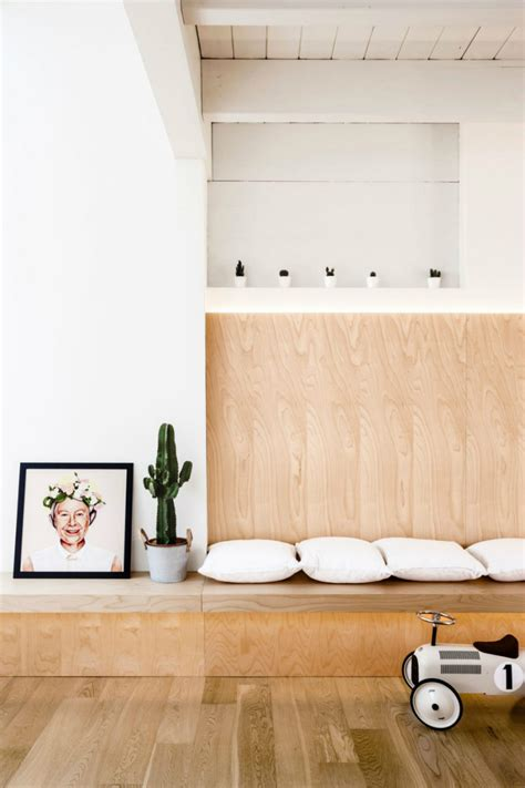 bench built into wall this modern italian apartment is designed in wood
