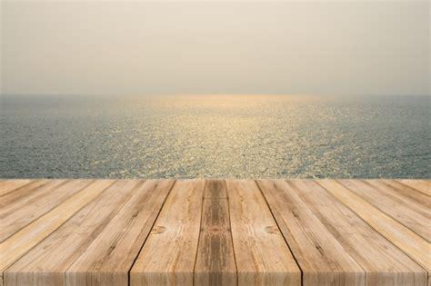 tavole di mare tavole di legno con lo sfondo mare scaricare foto gratis