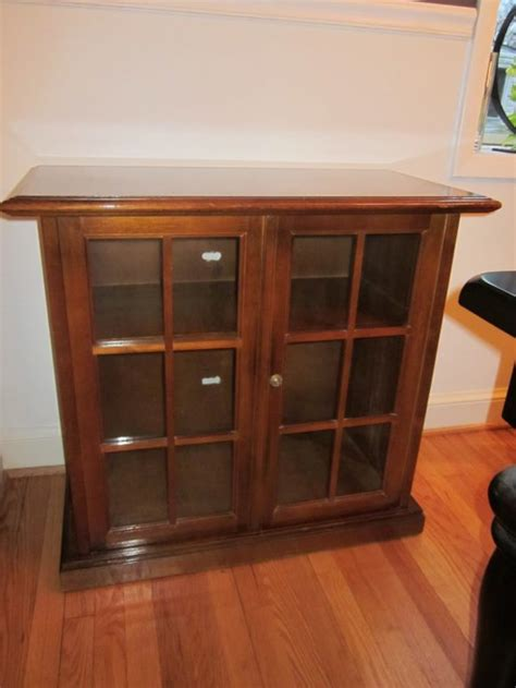 Furniture Small Wood Dvd Storage With Glass Doors And Dvd Storage Cabinet With Glass Doors