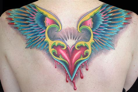 colored wings tattoo color of a flying bleeding the wings