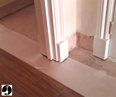 laying laminate in a doorway