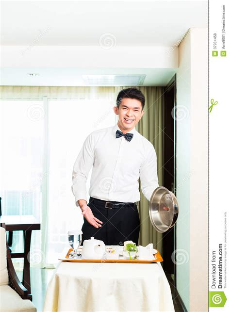 asian room waiter serving guests food in hotel royalty free stock photos image 37934458