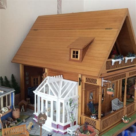 dolls house exchange for sale chalet style dollshouse with conservatory shed greenhouse garden area