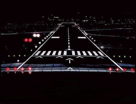 runway lights at night airport runway at night photograph by lamyl hammoudi