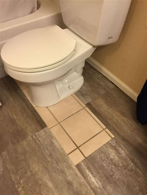 DIY Luxury vinyl Tile Cover ugly old tile!   bathroom redo