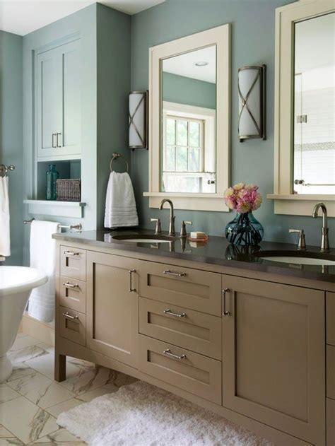 taupe dusty blue white muted blue walls surround this bathroom with calming energy the