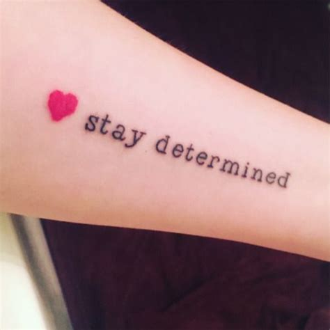 determination tattoo quot stay determined quot in serifed bold arrow quot focused