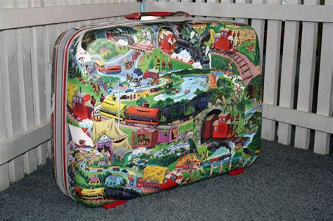 How To Decoupage A Suitcase - decoupage suitcase with trains and engines
