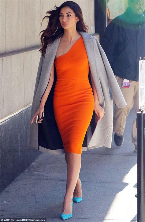 Dress Model Style Pink Blue Brown Impor aldridge wears a slinky orange dress to promote
