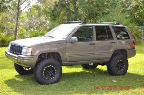 green jeep cherokee lifted 1j4gz78s2vc556555 1997 grand cherokee zj with 4 quot lift