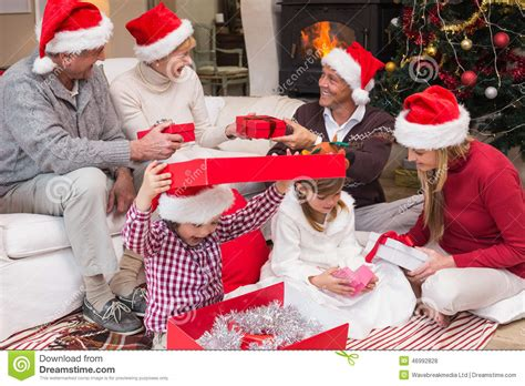 happy family opening christmas gifts together stock photo