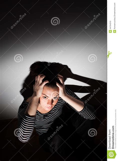 harsh lighting young woman suffering from a severe depression stock photo