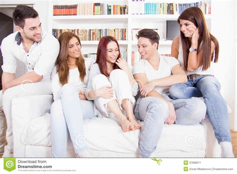 having on the sofa friends having conversation on sofa royalty free stock