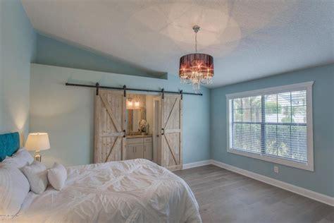Master Bedroom Barn Door Traditional Master Bedroom With Hardwood Floors Barn