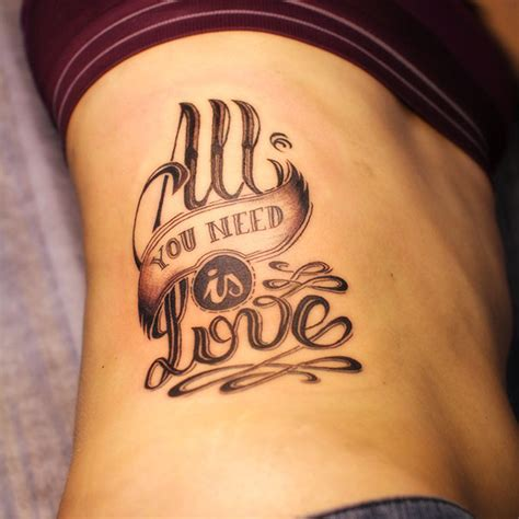 tattoo love is all quot all you need is love quot tattoo design on behance
