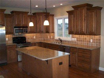 medium brown cabinets with granite countertops 13 best images about kitchens on kitchen