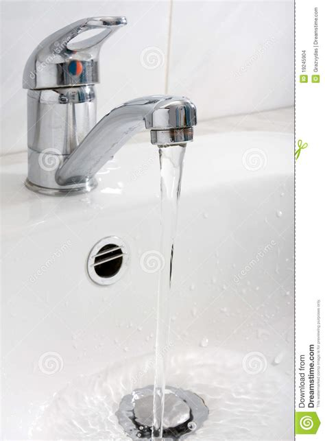 water running from the faucet stock images image