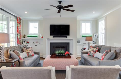 two loveseats in living room built in cabinets around fireplace family room traditional