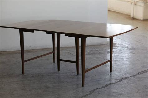 extendable drop leaf maple dining table by paul mccobb for